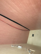 Unwrapped wall and ceiling boards and outlet cutouts in bunks
